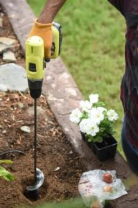 Handheld auger used for garden planting