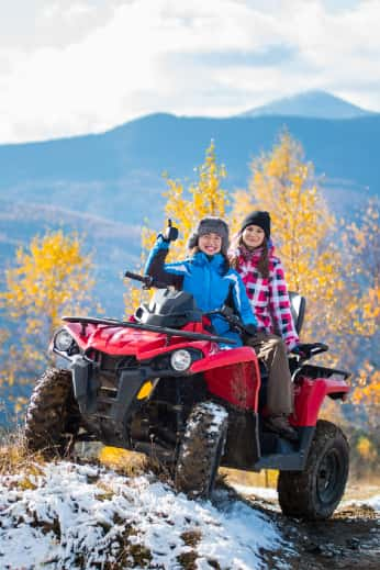 Two women riders on an ATV