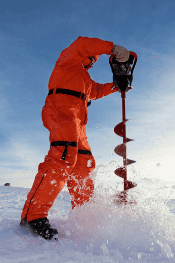 Ice auger being used on a lake